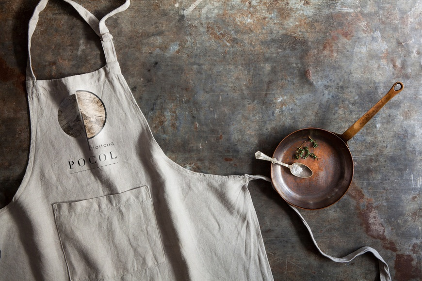Kitchen apron with frying pan and spoon